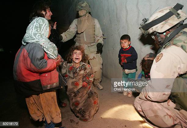 Iraqi children cry after their parents were killed when US Soldiers with the 1st Battalion 5th Infantry Stryker Brigade Combat Team of the 25th...