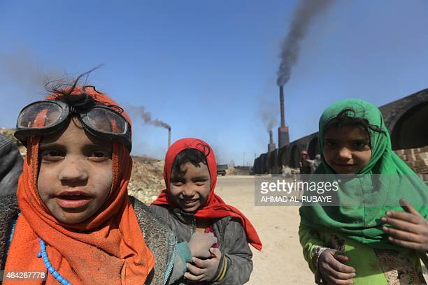 Iraqi children employed at the traditional brick factory of Nahrawan one of the largest brick factories in Iraq located on the eastern outskirts of...