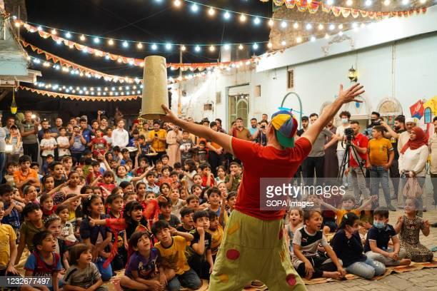 Iraqi Children interact with Italian clown Marco Rodari,performing an entertainment show for them. An entertainment show is staged by the Italian...