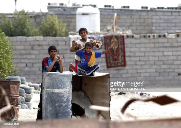 Iraqi children play in alZubair south of Basra on February 11 2018 Informal housing settlements are flourishing in the oilrich province of Basra as...