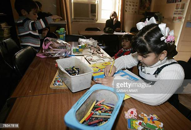 Iraqi children play with toys and draw on colouring books at the Public Library of the Iraqi Child in central Baghdad 08 December 2007 The library...