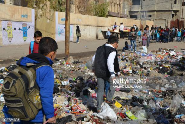 Iraqi children walk to school in the battered city of Mosul on December 27 2017 Through games mime and sport an instructor aims to help show the...