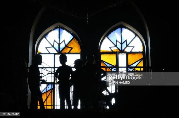 Iraqi Christian children are seen as they attend a mass at the Church of the Immaculate Conception on July 24 2017 in the predominantly Christian...
