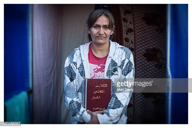 Iraqi Christian, Heleen Dawood, poses for a photograph in her tented home erected in the grounds of Mazar Mar Eillia Catholic Church, that has now...