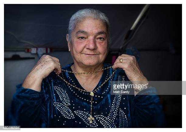 Iraqi Christian Jandark Jibrael poses for a photograph in her tented home erected in the grounds of Mazar Mar Eillia Catholic Church that has now...