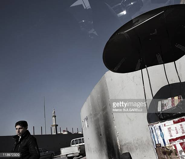 Iraqi Christian refugees In Damascus Syria On January 21 2011A man sells cigarettes on the streets of Jaramana suburb Since 2003 and the beginning of...