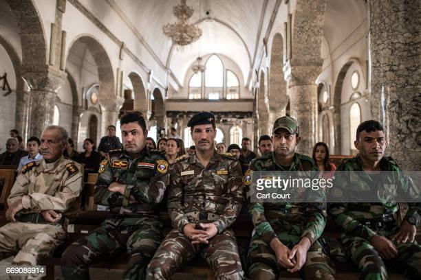 Iraqi Christian soldiers attend an easter ceremony at Saint John's Church in the nearly deserted predominantly Christian Iraqi town of Qaraqosh on...