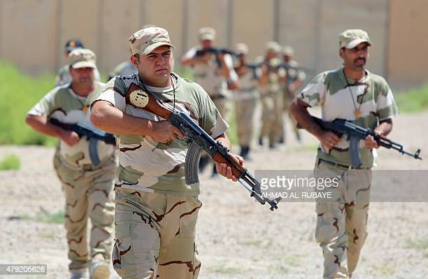 Iraqi Christian volunteer fighters from Baghdad and the northern embattled Mosul governorate attend a training session at a base in Baghdad airport...