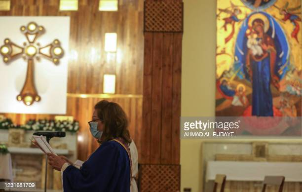 Iraqi Christian Wajdane Nouri leads the choir at St. Joseph Church in central Baghdad on March 10 during a mass held following the visit of Pope...