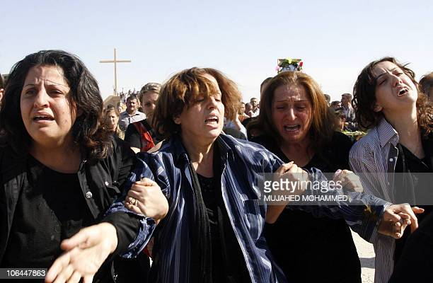 Iraqi Christian women mourn their killed relatives during a funeral procession in Mosul on November 2 2010 for the victims of the Syrian Catholic...