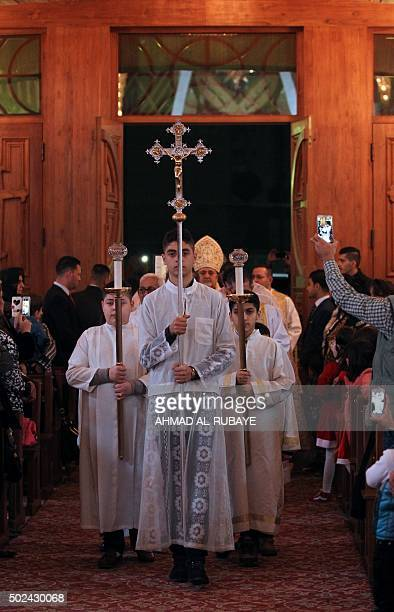 Iraqi Christians and priests hold a Christmas mass at the Catholic Church of Our Lady of Deliverance/Salvation in central Baghdad on December 24 2015...
