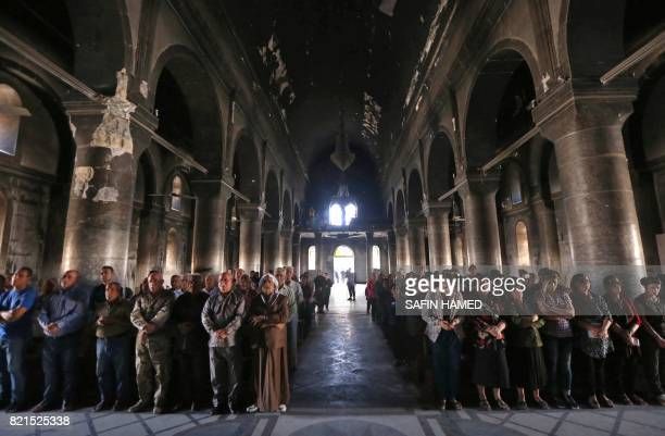 TOPSHOT Iraqi Christians attend a mass at the Church of the Immaculate Conception on July 24 2017 in the predominantly Christian Iraqi town of...