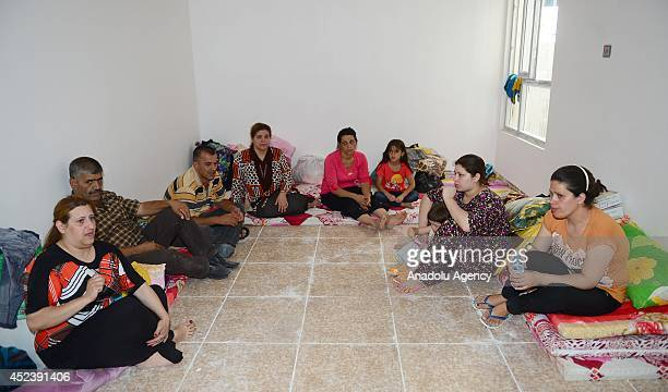 Iraqi Christians family fleeing violence in the northern city of Mosul arrive at Arbil on July 19 2014 Hundreds of Christian families fled their...