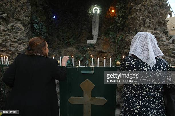 Iraqi Christians light candles after Sunday mass at the Sayidat alNejat Catholic Cathedral or Syrian Catholic Church in central Baghdad on November 7...