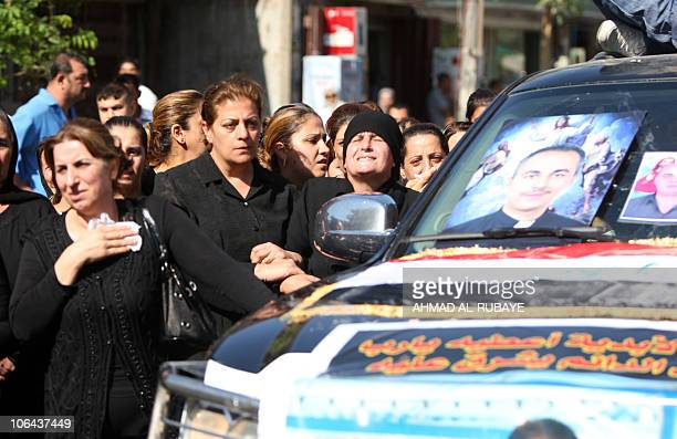 Iraqi Christians mourn on November 02 in Baghdad during the funeral procession for the victims of the Syrian Catholic cathedral carnage in which more...