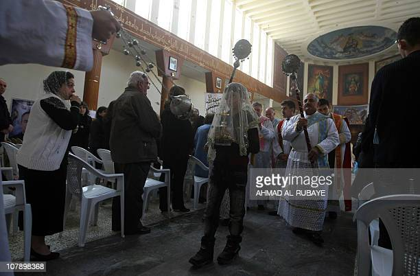 Iraqi Christians pray during an Epiphany Day mass in the Church of Our Lady of Deliverance/Salvation in central Baghdad on January 6 2011 more than...