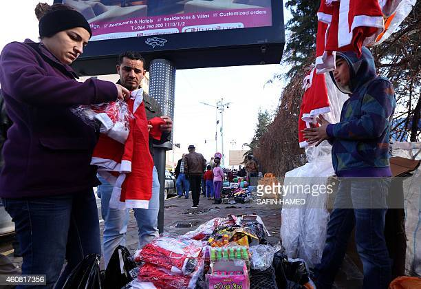 Iraqi Christians who fled the violence in the northern Iraqi city of Mosul buy Christmas paraphernalia in Arbil the capital of the Kurdish autonomous...