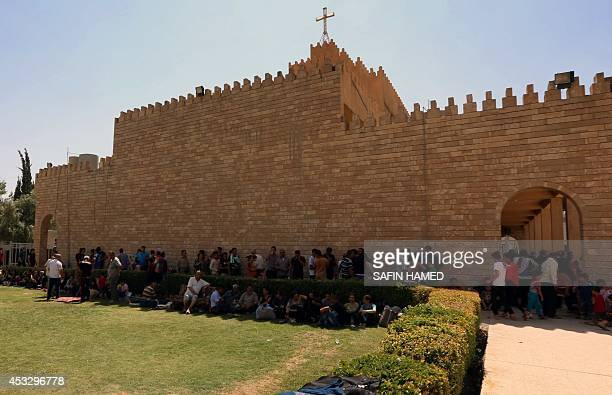 Iraqi Christians who fled the violence in the village of Qaraqush about 30 kilometres east of the northern province of Nineveh rest upon their...