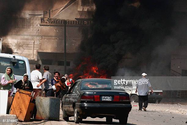 Iraqi citizen's flee the scene after three explosions September 30 2004 in Baghdad Iraq Three seperate explosions near a US military convoy which was...