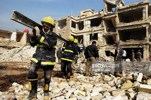Iraqi civil defense forces clean the site where two suicide car bombs exploded near Alhamra hotel on November 18 2005 Baghdad Iraq Two suicide...