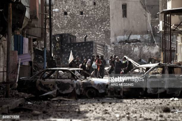 Iraqi civilians flee Mosul as Iraqi forces advance inside the city during fighting against Islamic State group's fighters on March 8, 2017. Supported...