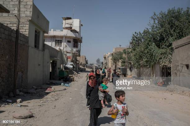 Iraqi civilians flee the Old City of west Mosul where heavy fighting continues on June 23 2017 Iraqi forces continue to encounter stiff resistance...