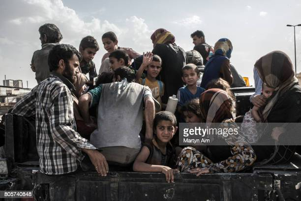 Iraqi civilians in an Iraqi ISOF forces humvee are fleeing the Old City district where heavy fighting continues on July 2 2017 in Mosul Iraq Iraqi...