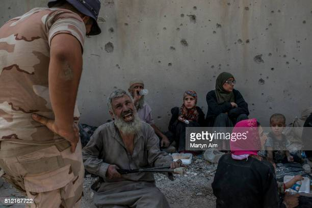 Iraqi civilians in the Islamic State occupied Old City district on July 10 2017 in Mosul Iraq The Iraqi government and armed forces have declared...