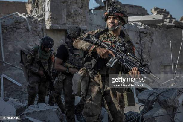 Iraqi commandos advance through alNuri mosque complex on June 29 2017 The Iraqi Army Special Operations Forces and CounterTerrorism Services made a...