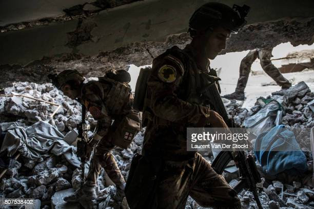 Iraqi commandos advance through ruins of alNuri mosque complex on June 29 2017 The Iraqi Army Special Operations Forces and CounterTerrorism Services...