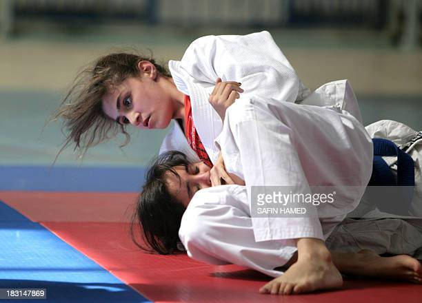 Iraqi contestants compete in the U16 category of the national women's judo championship in Arbil the capital of Iraqs autonomous Kurdistan Region on...