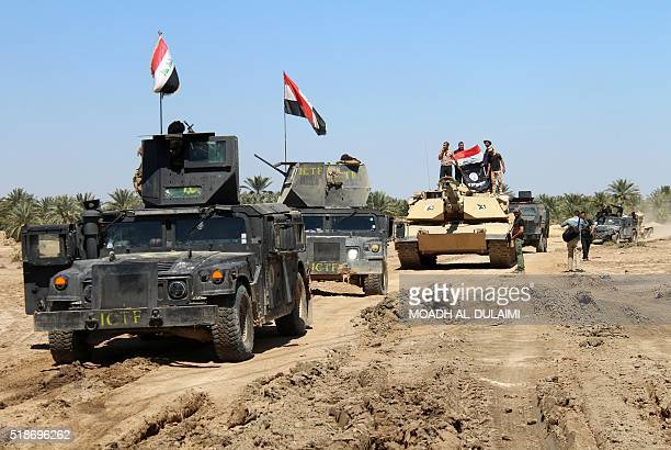Iraqi Counter Terrorism Forces drive their armored vehicles after they retook an area from the Islamic State group on April 2 2016 in the village of...