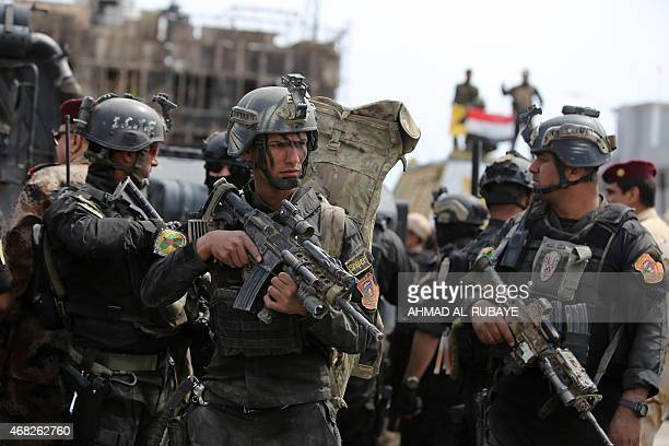 Iraqi counterterrorism forces patrol a street in Tikrit on April 1 a day after the prime minister declared victory in the weekslong battle to retake...