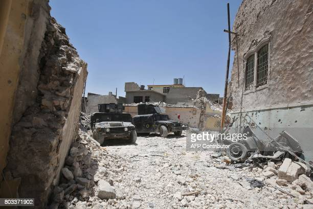 Iraqi CounterTerrorism Service humvees advance towards the Grand Mosque of Nuri in the Old City of Mosul on June 29 during the ongoing offensive by...