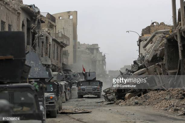 Iraqi Counter-Terrorism Service vehicles are seen in the old city of Mosul on July 7 during the Iraqi government forces' offensive to retake the city...