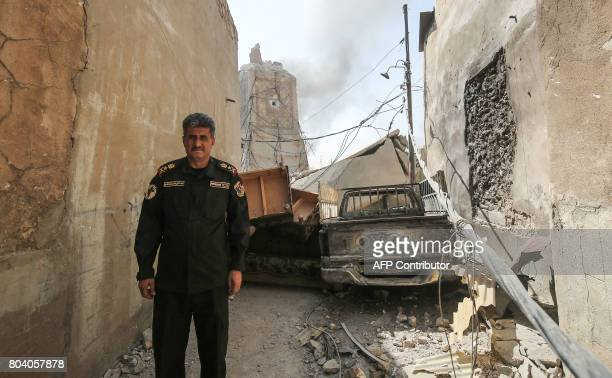 Iraqi CounterTerrorism Services chief of staff LieutenantGeneral AbdulWahab alSaadi poses for a picture with the background showing the base of...