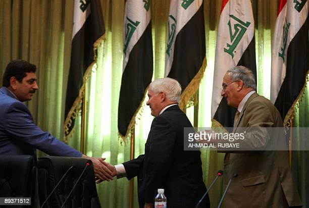 Iraqi Defence Ministry Spokesman Major General Mohammed AlAskari Shakes Hands With US Secretary Robert Gates