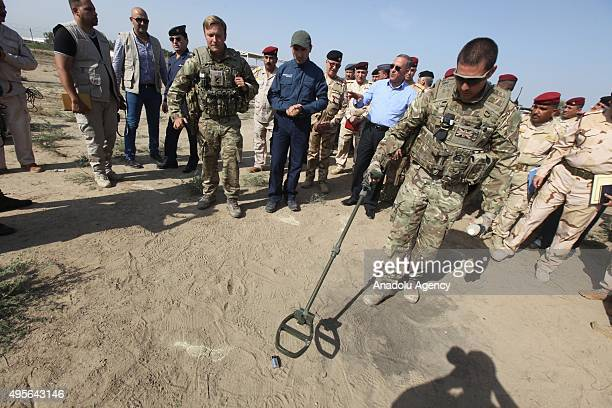 Iraqi Defense Minister Khaled alObeidi gets information about military equipment together with the Australian military advisors and volunteer...