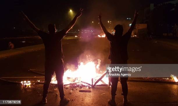 Iraqi demonstrators burn tires and block roads during an antigovernment protests in capital Baghdad's Palestine Street on October 5 2019