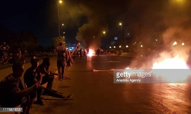 Iraqi demonstrators burn tires and block roads during an anti-government protests in capital Baghdad's Palestine Street on October 5, 2019.