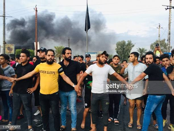 Iraqi demonstrators gather during an anti-government protests against unemployment, corruption in Baghdad, Iraq on October 7, 2019.