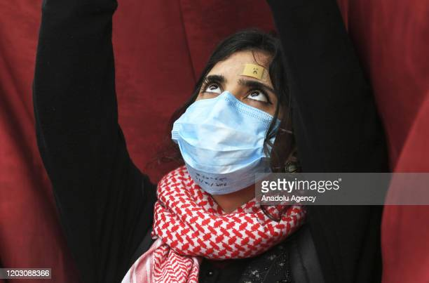 Iraqi demonstrators gather for anti-government protest at Tahrir Square in Baghdad, Iraq on February 25, 2020. Some demonstrators, wearing face...