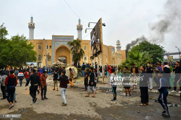 Iraqi demonstrators gather in front of the shrine dedicated to the late Iraqi Shiite Ayatollah Mohammed Baqir alHakim in the southern Iraqi Shiite...