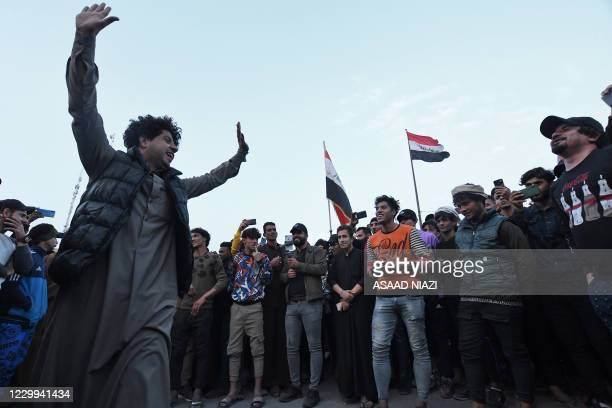 Iraqi demonstrators gather in Habboubi Square in the southern city of Nasiriyah in Dhi Qar province, on December 4 to express anger after followers...