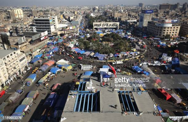 Iraqi demonstrators gather in Tahrir square in the capital Baghdad on December 20, 2019 during ongoing anti-government protests. - Iraq's top Shiite...