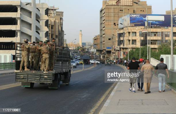 Iraqi demonstrators try to enter Green Zone as they gather for a demonstration against Iraqi government in Baghdad Iraq on October 01 2019