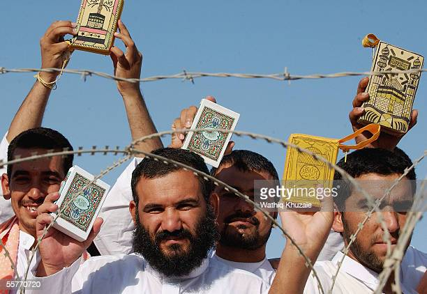 Iraqi detainees hold copies of the holy Quran as they stand in line to be processed for release from Abu Ghraib prison facility on September 26 2005...