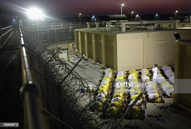 Iraqi detainees pray at the Camp Cropper detention center September 19 2007 in Baghdad Iraq US forces have a total of some 25000 detainees in several...