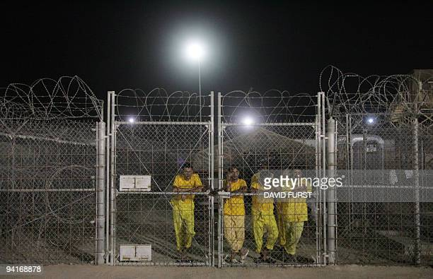 Iraqi detainees stand behind a fence at the Camp Bucca detention centre located near the KuwaitIraq border on May 19 2008 There are approximately...