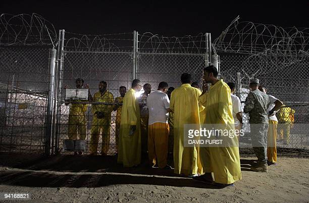Iraqi detainees talk to one another through a fence inside the Camp Bucca detention centre located near the KuwaitIraq border on May 19 2008 There...
